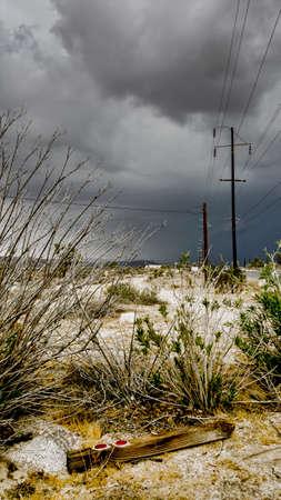 desert storm: Storm clouds approach a broken warning post in a California desert.
