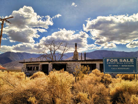 crumbling: An abandoned crumbling house for sale in a California desert.