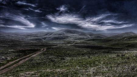 A moonlit road through green hills. Banque d'images