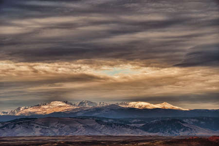 chaparral: A storm over snow capped eastern sierra mountains. Stock Photo