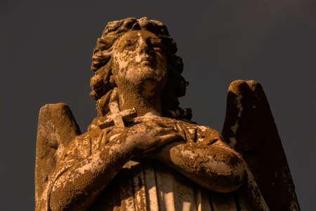 reverent: Angel statue with cross