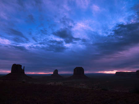 Dawn breaks over Monument Valley National Monument. Stock Photo