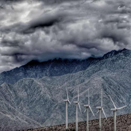 Five wind power windmills in the California desert.