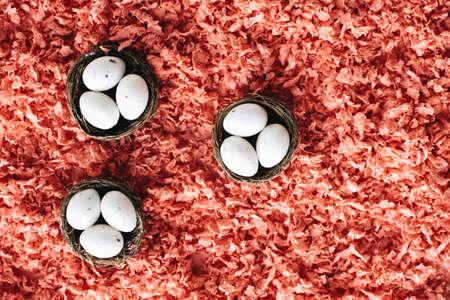 Easter white eggs in three small baskets Standard-Bild - 122598929