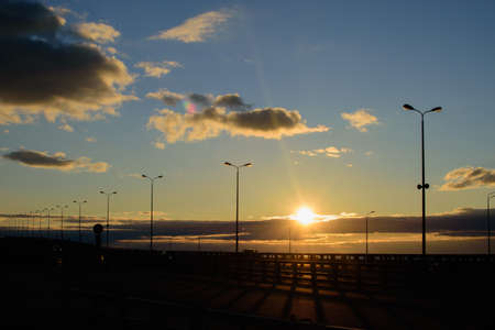 Sunset with beautiful big clouds seen on the highway. Reklamní fotografie