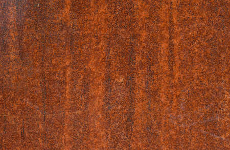 Superficie de metal oxidada con color naranja, textura de fondo.