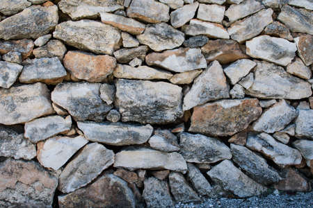 Wall of large natural stones, natural background. Great for design and texture background.