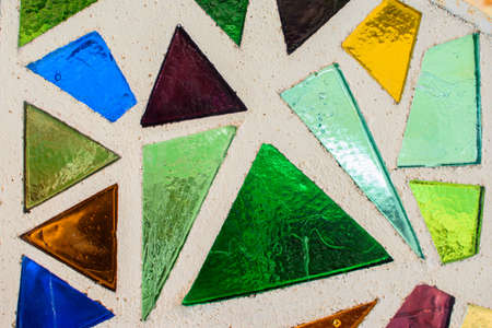 Mosaic surface made of multi-colored glass. Abstract mosaic glass tiles patterned background. CLose up. Imagens