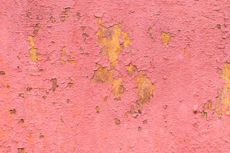 Old peeling paint on a pink metal surface. Textured background. Great for design and texture background.