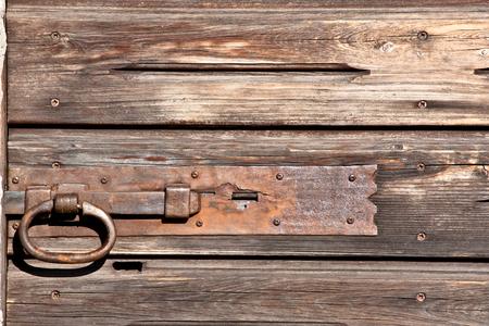 door bolt: texture of  old wood door with ferrious bolt bar