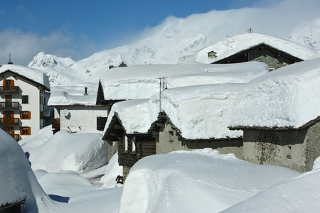 non moving activity: White deep snow on the roof of the houses in  mountains village Stock Photo