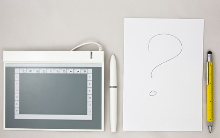 electronical: choice between electronical modern graphic tabler for drawing anf traditional paper sheet with a pen , layout Stock Photo
