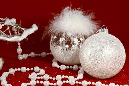 Christmas new year decorations toy , white fluffy crystal bubbles, white beads at the red background Stock Photo