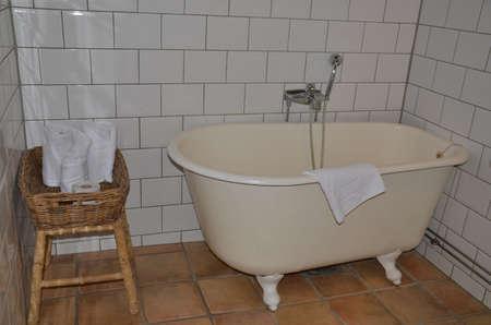 bathtowel: Old bath in a bathroom with white tile