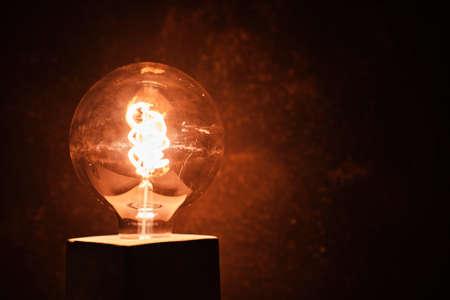 an incandescent led light with a dark background - idea concept Standard-Bild - 147655348