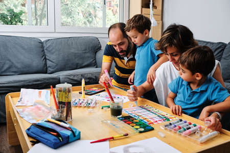 a family painting and playing with their kids