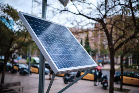A solar panel in the middle of the city. Sustainability concept