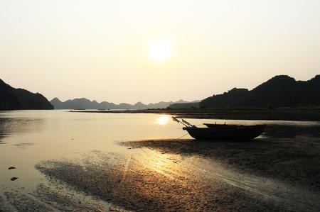halong: Halong bayat sunset time with a boat