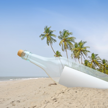 Bottle with message inside in a paradise. Stock Photo - 10411924