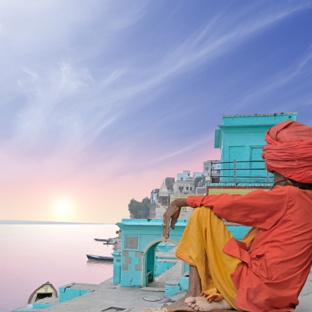 poorness: Holy man near Ganges in the morning.
