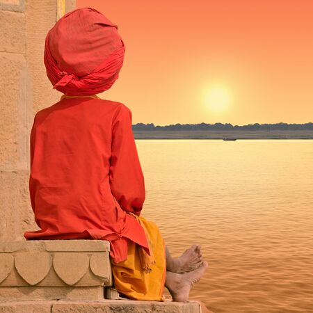 Holy man near Ganges in Varanasi, India. Stock Photo