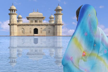 exotism: Indian architecture and elegant woman with sari.