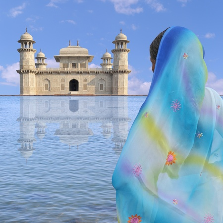 exotism: Woman with sari near a palace in India.