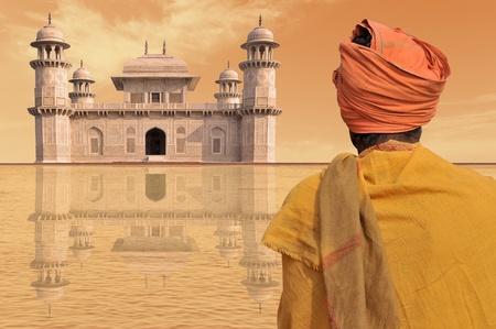 hombre pobre: Pobre hombre cerca de un palacio de lujo en la India.