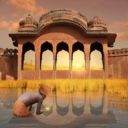 ritual: Hinduist man doing a ritual in India. Stock Photo