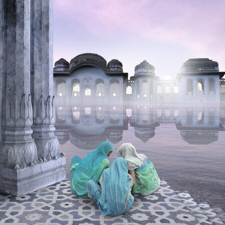 hinduist: Women with sarees in the morning on the Ganges. Stock Photo