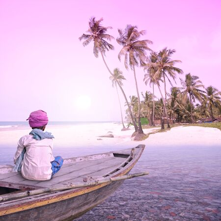 Fisherman working in a paradise in the south of India. Stock Photo