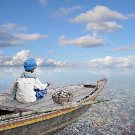 warm water fish: Fisherman working in his boat on the sea.