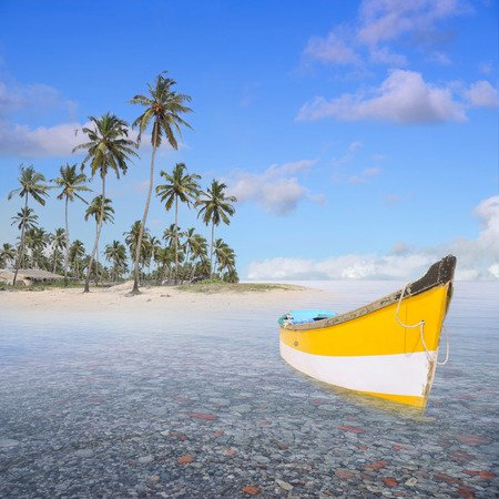 Boat near a lonely beach in the paradise. Stock Photo