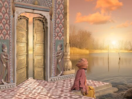 Traditional Indian man near a door in the sunset. Stock Photo