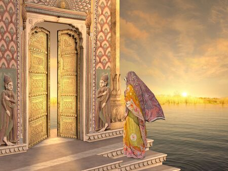 Woman near a traditional indian door in the sunrise. Stock Photo