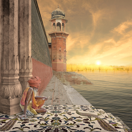 oasis at sunrise: Religious old man reading on the Ganges river.