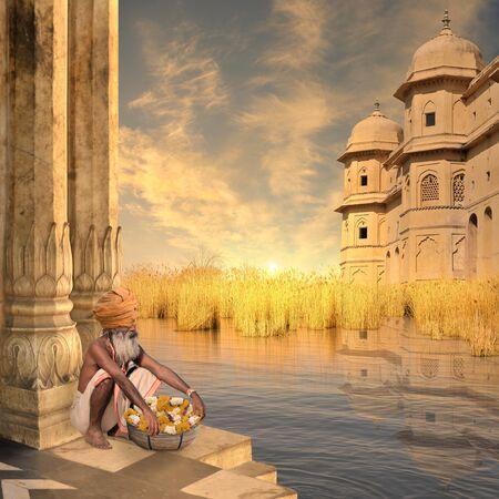 sadhu: Indian sadhu on the Ganges river in a warm sunrise.