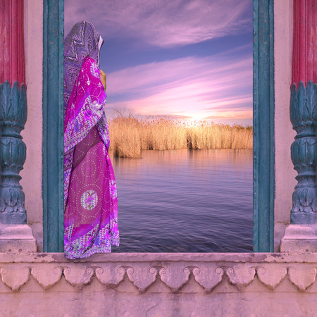 river: Indian woman with saree on the Ganges river.