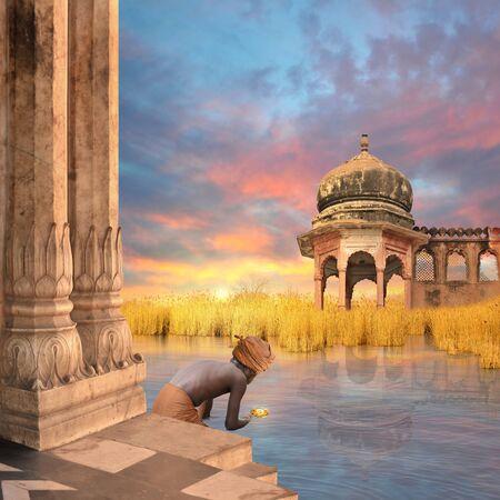 ritual: Man doing a hindu ritual on the Ganges river. Stock Photo
