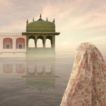 oasis at sunrise: Indian woman with the traditional saree in the mist.