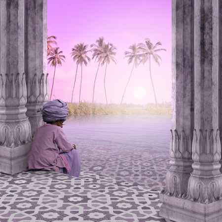 oasis at sunrise: Holy man meditating on the beach during the sunrise. Stock Photo