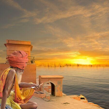 sadhu: Sadhu reading a religious book in the indian coast. Stock Photo