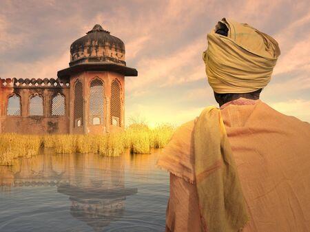 poor man: hombre pobre indio cerca del r�o Ganges en la puesta de sol.