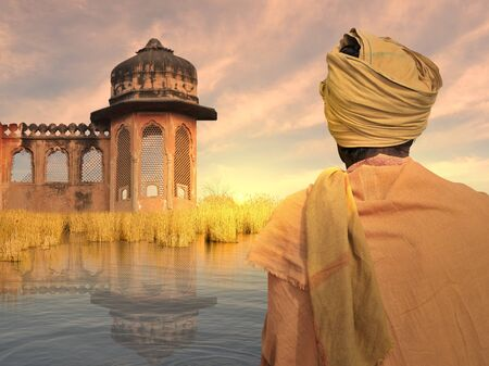 poor man: Indian poor man near Ganges river in the sunset. Stock Photo