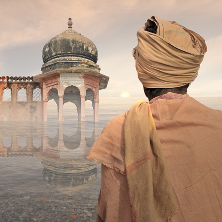 Poor man near traditional indian art on the water. Stock Photo