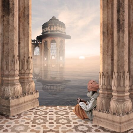 Old man praying in a hindu temple in the mist. Stock Photo