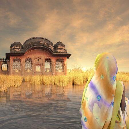 Old indian temple on the Ganges river in the sunset. Stock Photo