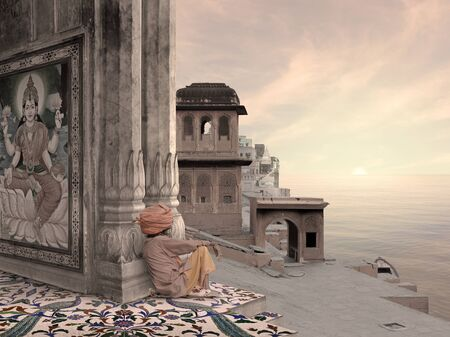Holy man near indian coast during the sunrise.