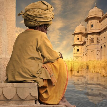 Indian man with the traditional turban near Ganges river. Stock Photo