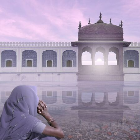 Woman near indian palace in the mist.